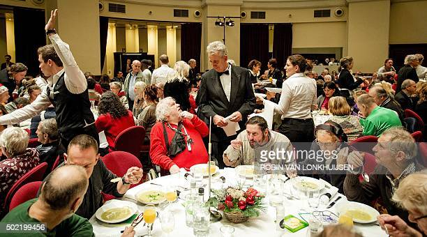 Homeless people and others enjoy an annual Christmas supper offered by the Dutch Salvation Army in the Koepelkerk in Amsterdam on December 21 2015 /...