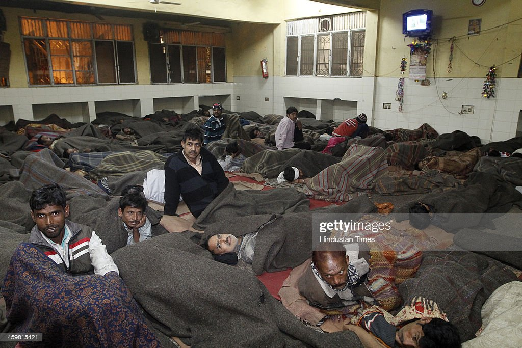 Homeless people at Baba Khadak Singh Marg night shelter during chilly night on December 31, 2013 in New Delhi, India. Delhi Urban Development Minister, Manish Sisodia took a surprise inspection of the night shelters in the city to check the plight of the shivering poor.