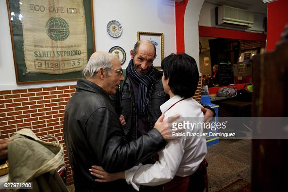 Homeless people congratulate a waiter as they leave after having a free dinner at Robin Hood restaurant on December 5 2016 in Madrid Spain...