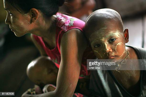 Homeless people find shelter in a school at the isolated village of Myasein Kan on May 20 2008 in the Ayeyarwaddy delta Myanmar It has been estimated...