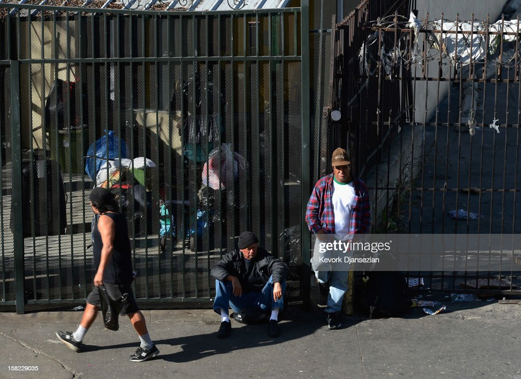 Homeless people from Skid Row are seen on the streets around a construction project where102 prefabricated housing units placed on top of the second floor of Star Apartments are being built December 11, 2012 in Los Angeles, California. The modular homes will become the first multi unit prefabricated homes in Los Angeles for formerly homeless and impoverished people. Despite efforts from the Federal Government and local officials to provide more shelters and beds for homeless people, the number of people living on the streets remained unchanged from January 2011 to January 2012. The number of homeless families increased while the number of veterans on the street decreased.