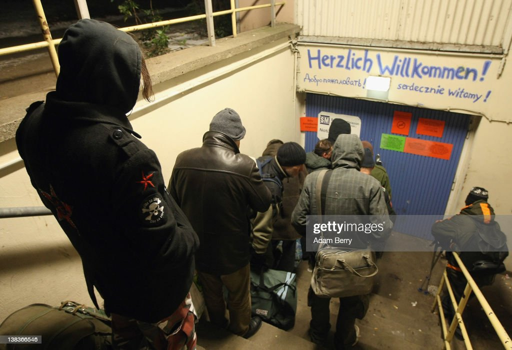 Homeless people line up at a shelter on February 6, 2012 in Berlin, Germany. Waermebus, a program ran by the German Red Cross, assists the homeless in times of extremely low temperatures with blankets, food, clothing and finding lodging. Nearly 300 people across Europe have died during the current cold wave, a majority of whom were without shelter.