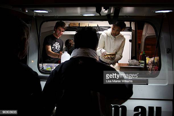 Homeless people line up at the Youth Off The Streets food van and outreach service at Green Park Darlinghurst on on September 2 2009 in Sydney...