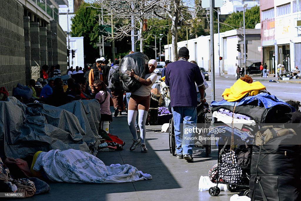 Homeless people rest on a public sidewalk February 28, 2013 in downtown skid row area of Los Angeles, California. Los Angeles officials will ask U.S. Supreme Court to overturn a lower-court ruling preventing the destruction and random seizures of belongings that homeless people leave temporarily unatteneded on public sidewalks. The lower court ruling has hindered cleanup efforts.