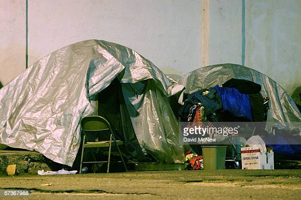 Homeless people sleep in their encampments on downtown sidewalks in the early morning hours off April 19 2006 in Los Angeles California Most homeless...