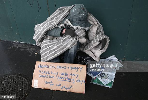 A homeless person bundles against the cold during a snowstorm on January 21 2014 in New York City Areas of the Northeast are predicted to receive up...
