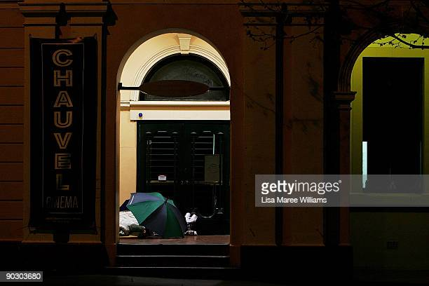 A homeless person sleeps in a doorway along Oxford Street on September 2 2009 in Sydney Australia Tomorrow sees the start of the 2day National...