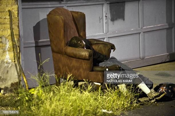 A homeless person sleeps in an armchair in an alleyway in Washington early on September 1 2010 Modern homelessness started as a result of the...