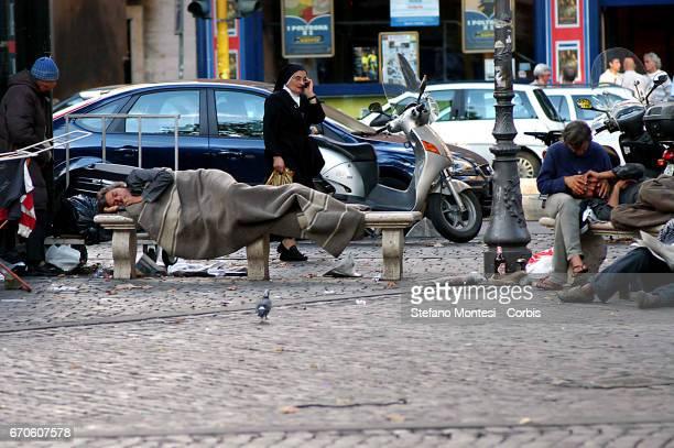 A homeless person sleeps on the street in Viale Trastevere on September 18 2006 in Rome Italy