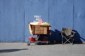A homeless person's grocery cart and chair is shown along Fifth Avenue during the annual Veterans Day parade November 11 2006 in New York City The...