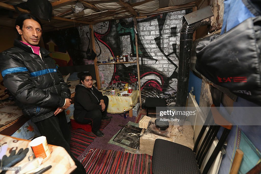 Homeless Roma from Bulgaria keep warm in front of a makeshift oven they've installed in their shelter in a former ice factory known locally as the Eisfabrik on December 27, 2013 in Berlin, Germany. The future of several homeless members of the Roma community, mostly from Bulgaria, remains uncertain as officials decide whether to evict those who have taken up residence over the past two years in the decayed structure. Citizens of Romania and Bulgaria, countries which joined the European Union in 2007, will be granted full access to European job markets next year, which some critics fear may bring about 'welfare tourism,' seeing squats such as those in the Eisfabrik as a warning of what will come if the immigration is unregulated.