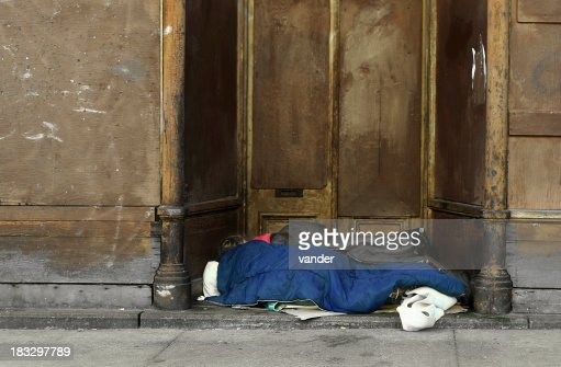 Homeless sleeping on ground.