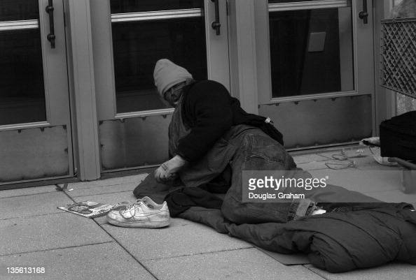 A homeless sleeps in a doorway of a business in subfreezing weather on Massachusetts Avenue near Capitol Hill