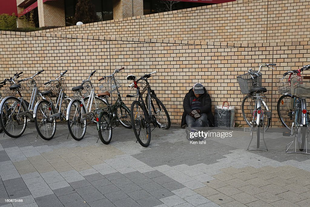 A homeless spend time at bicycle parking lot near Shunjuku Central Park on February 7, 2013 in Tokyo, Japan. A recent servey shows Tokyo as the most expensive city in the world and Osaka ranked second.