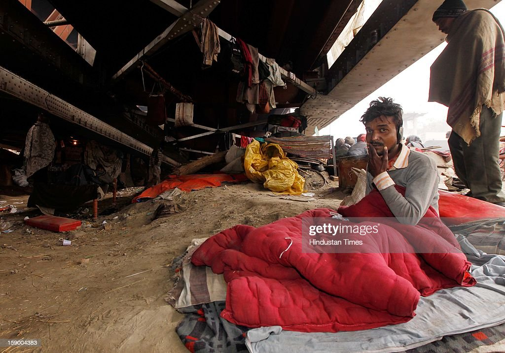 Homeless taking shelter under the old Yamuna Bridge as temperature dipped to minimum of 2.9 degrees four notches below normal on January 5, 2013 in New Delhi, India. More than 175 people have died so far in the bitter cold in Northern India. Government's efforts of providing night shelters to homeless are proving insufficient as many people have to spend their nights in open in this severe cold.