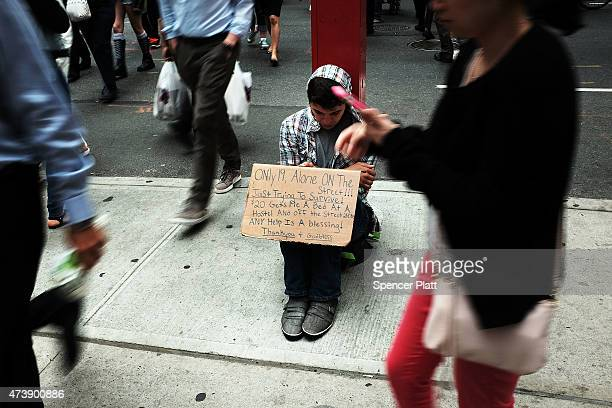 A homeless teen panhandles on a street near Eighth Avenue in Manhattan on May 18 2015 in New York City As many parts of once seedy New York City have...