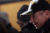 A homeless US military veteran stands in line for free winter clothing at a 'Stand Down' event hosted by the Department of Veterans Affairs on...