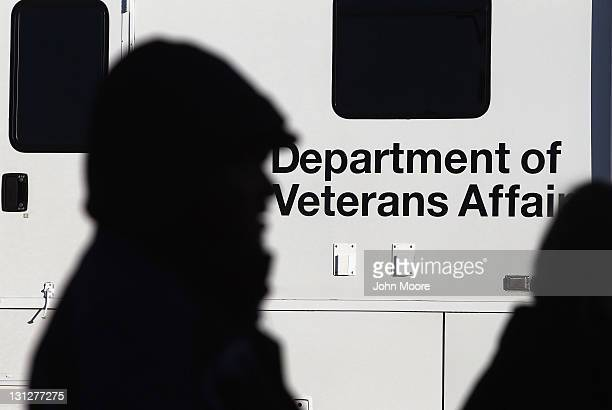 Homeless US military veterans stand in line for free services at a 'Stand Down' event hosted by the Department of Veterans Affairs on November 3 2011...