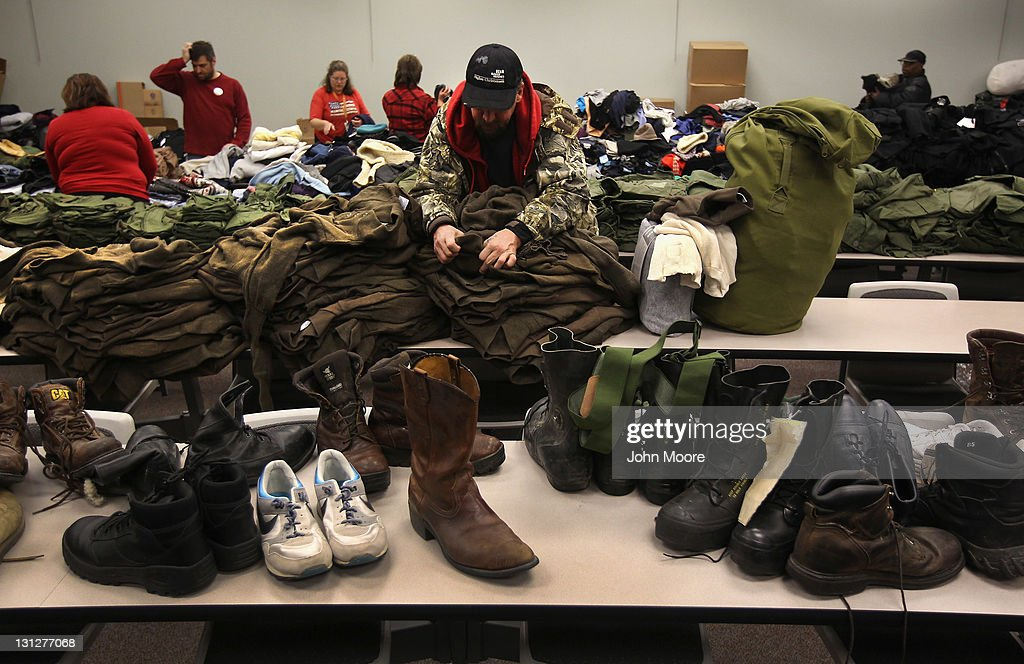 Homeless US Navy veteran Wayne Hamilton looks for his size while collecting free clothing at a 'Stand Down' event hosted by the Department of...
