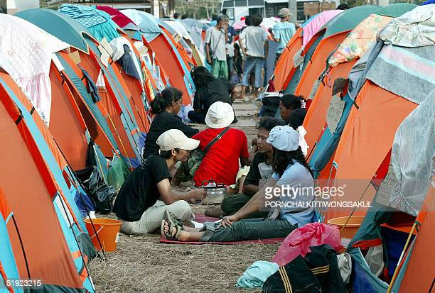 Homeless villagers take a rest next to temporary shelters at a relief camp at Ban Nam Khem in Phang Nga province southern Thailand 07 January 2005...