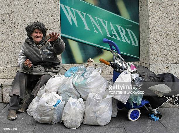 A homeless woman camps outside an office block shortly before the Reserve Bank of Australia announces its decision on official interest rates in...