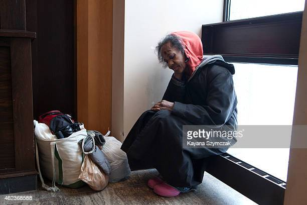 A homeless woman finds shelter inside the Copley Place Mall during a blizzard on January 27 2015 in Boston Massachusetts Twentysix inches of snow...