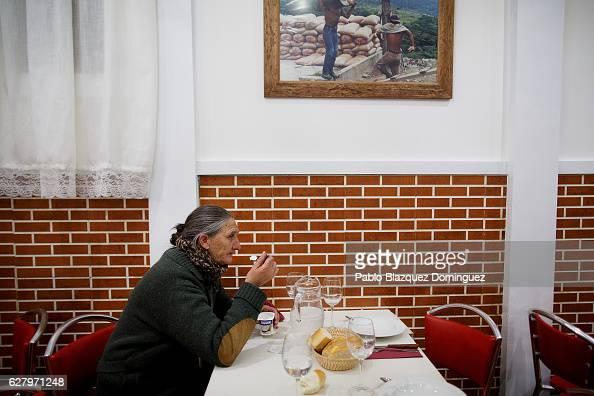 A homeless woman has a free dinner at Robin Hood restaurant on December 5 2016 in Madrid Spain Association Messengers Of Peace 'Mensajeros De La Paz'...