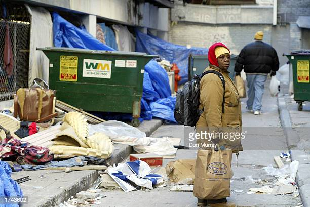 A homeless woman in a makeshift tent city learns that she and her partner will be able to spend the night in a shelter together January 24 2003 in...