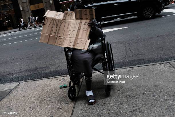 A homeless woman panhandles for money in Manhattan on July 24 2017 in New York City In its annual homeless count New York City recorded 3892 people...