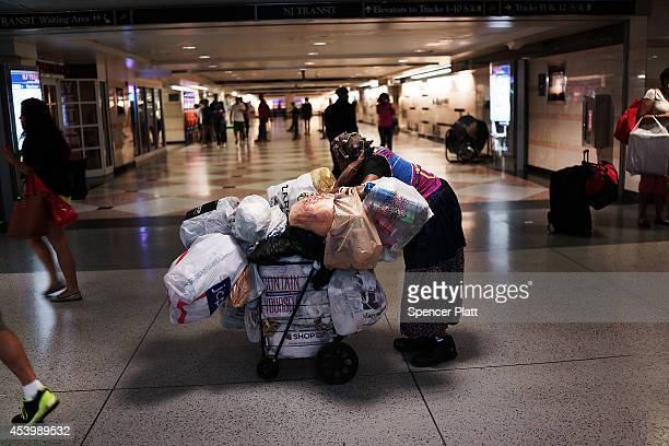 A homeless woman pauses in a Manhattan train station on August 22 2014 in New York City According to the Department of Homeless Services the number...