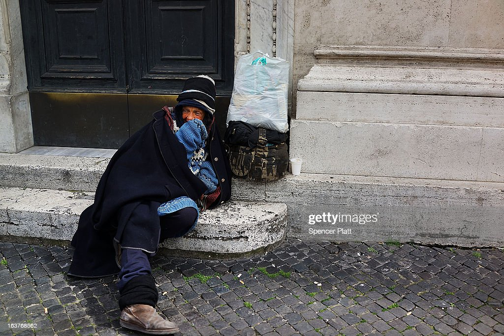 A homeless woman rests against the wall of a Catholic church on March 15, 2013 in Rome, Italy. Newly elected Pope Francis, formerly Cardinal Jorge Mario Bergoglio of Buenos Aires, has been a strong advocate for the poor and disenfranchised throughout the world. A Jesuit, Francis has followed the tradition of his order whose members live spartan, communal lives of poverty. Many analysts believe his papacy will see increased outreach and advocacy for the poor.