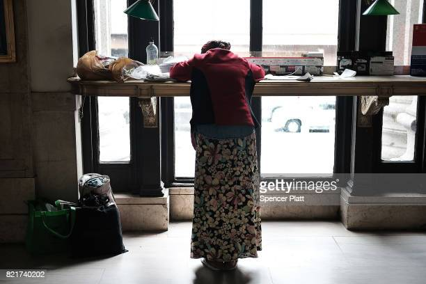 A homeless woman rests in a Manhattan building on July 24 2017 in New York City In its annual homeless count New York City recorded 3892 people...
