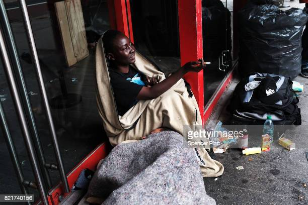 A homeless woman rests outside of a closed store in Manhattan on July 24 2017 in New York City In its annual homeless count New York City recorded...