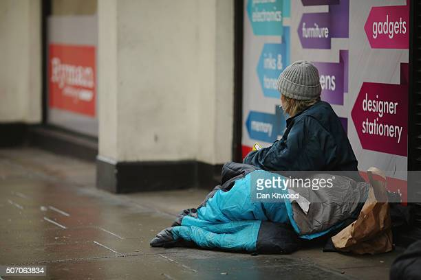 A homeless woman sits near Trafalgar Square on January 27 2016 in London England A group of 21 charities including Crisis St Mungos and Centrepoint...
