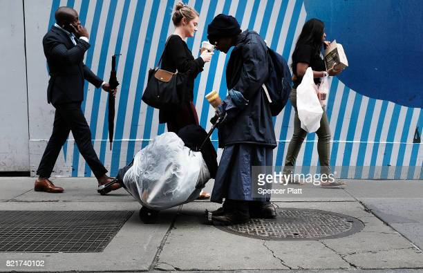 A homeless woman walks along a street in Manhattan on July 24 2017 in New York City In its annual homeless count New York City recorded 3892 people...