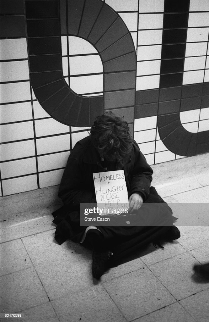A homeless youth begging for money on the London Underground, 21st January 1996.