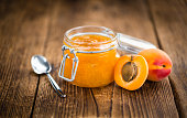 Fresh made Apricot Jam on a vintage background (close-up shot)