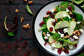 Homemade Autumn Apple Cranberry Salad with walnut, feta cheese and vegetables.