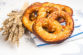 Traditional bavarian pretzel on white background. Oktoberfest background. Copy space