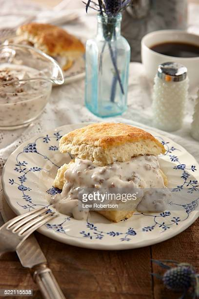 Homemade biscuits and gravy with coffee.