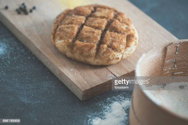 Homemade bread on wooden background