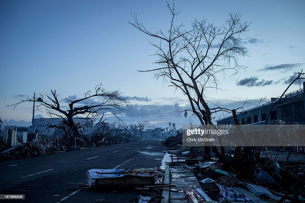 A homemade casket is seen on the side of the road as curfew approaches on November 14 2013 in Leyte Philippines Typhoon Haiyan which ripped through...