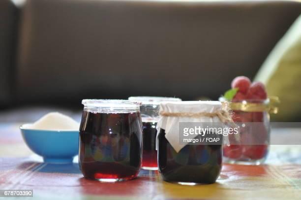 Homemade cherry jam on table