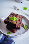 Homemade chocolate brownies on dark background