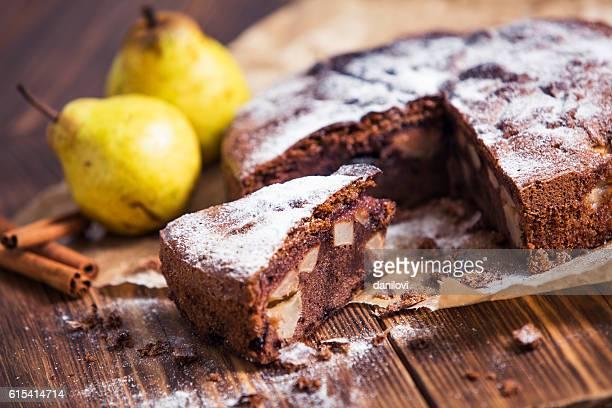 Homemade chocolate pie with pears and cinnamon