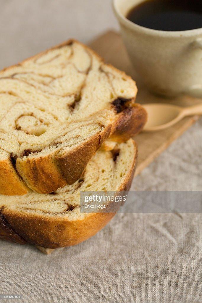 Homemade cinnamon roll with coffee : Stock Photo