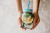 Homemade citrus lemonade or juice or mojito in a jar.