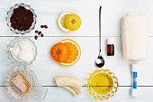 Homemade coffee scrub with grapeseed oil, sugar, yogurt, sea salt, orange, essence, lemon