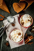 Cold Homemade Eggnog Ice Cream with Cinnamon and anise, on dark stone background, copy space top view