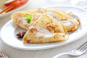 Bunch of homemade french crepes with sugar